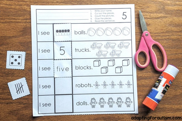 Photo of 1 cut and paste worksheet with 5 rows of 5 items and answer cards that show the number 5 in different formats.